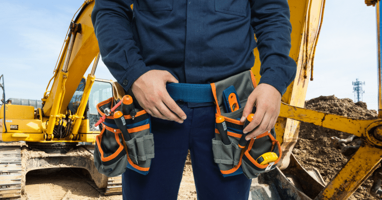 man wearing electrician tool belt